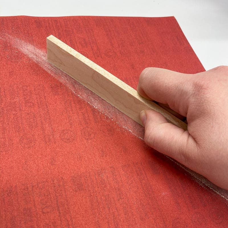 """sanding edges of ¼"""" maple with a full sheet of plywood on a workbench"""