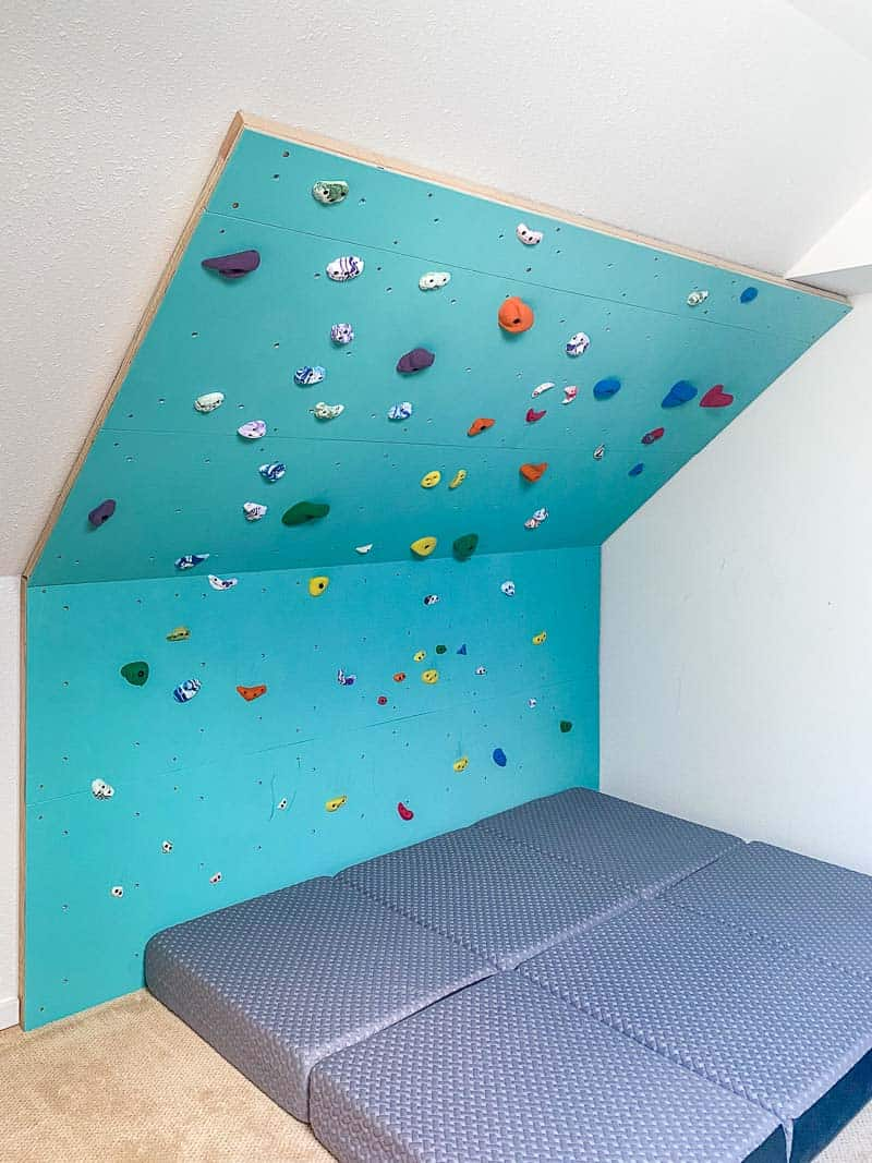 home climbing wall with foam mattress crash pads