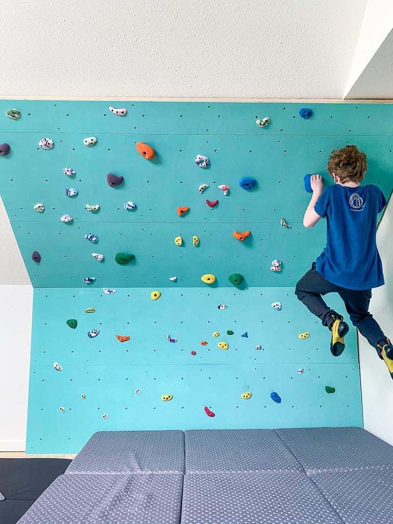kid doing pull up on home climbing wall