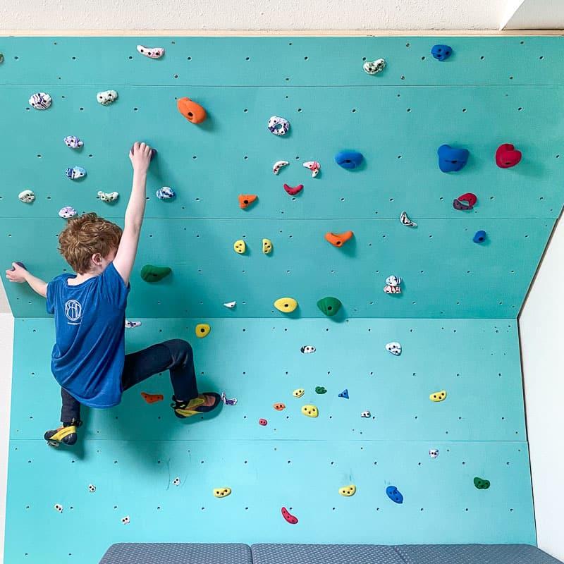 climbing on a home climbing gym