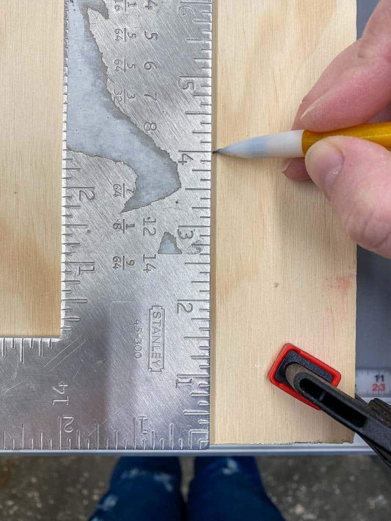 "marking 4"" perimeter around edge of climbing wall panel"
