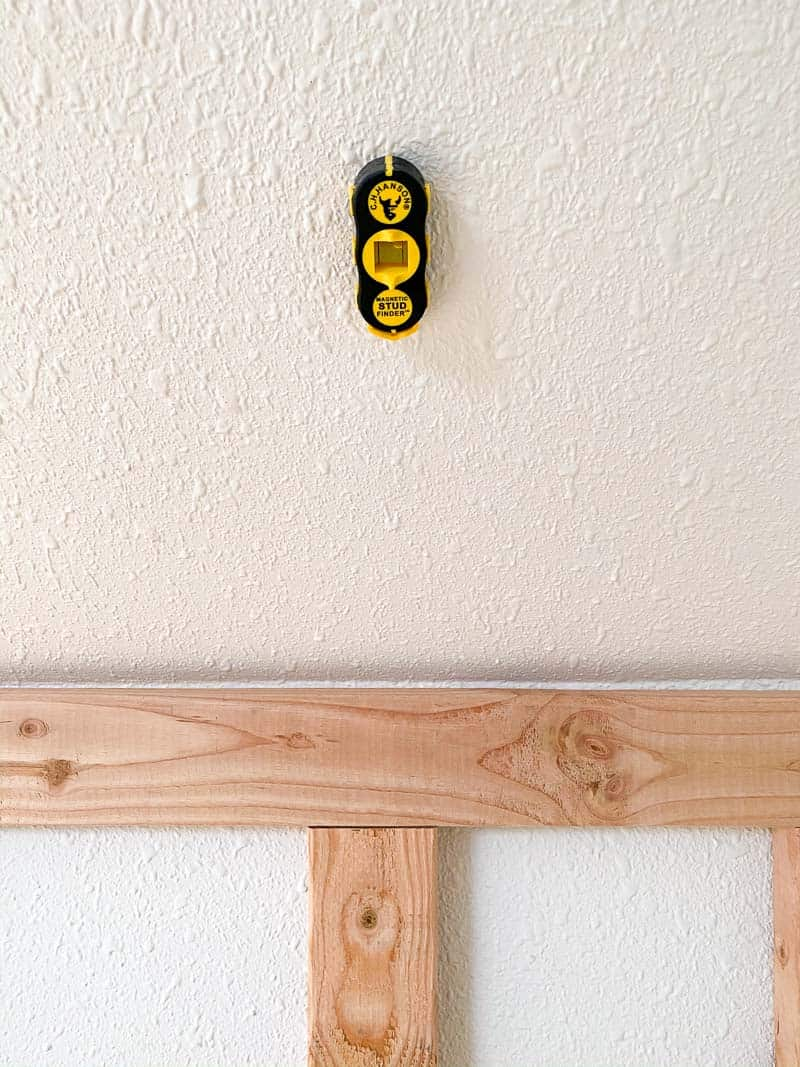 magnetic stud finder on wall
