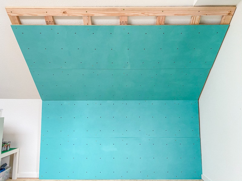 home climbing wall with one panel not yet installed to show frame