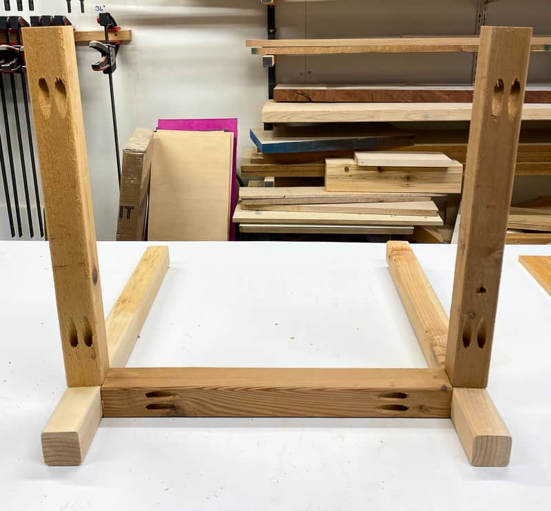 Attach the planter box legs to the frame with pocket hole screws.