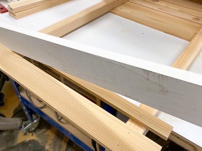 attaching the trellis slats onto the planter box