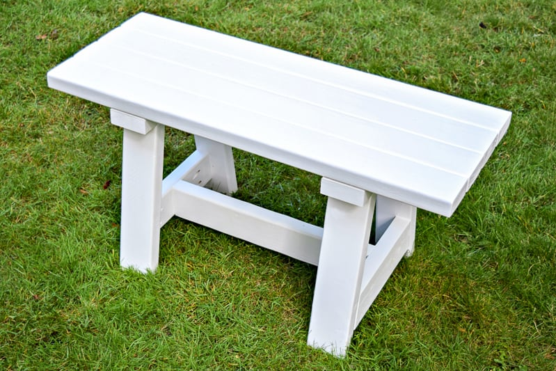 white 2x4 bench on grass