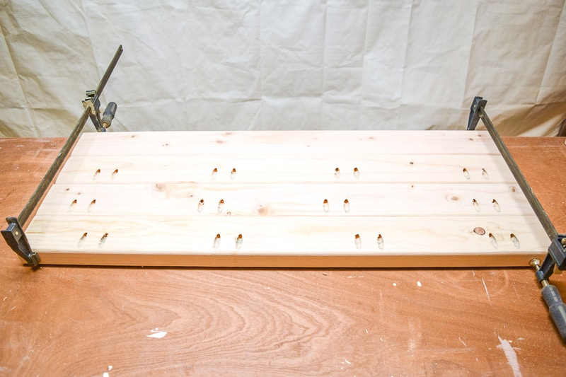 2x4 bench seat boards connected with pocket hole screws and clamps