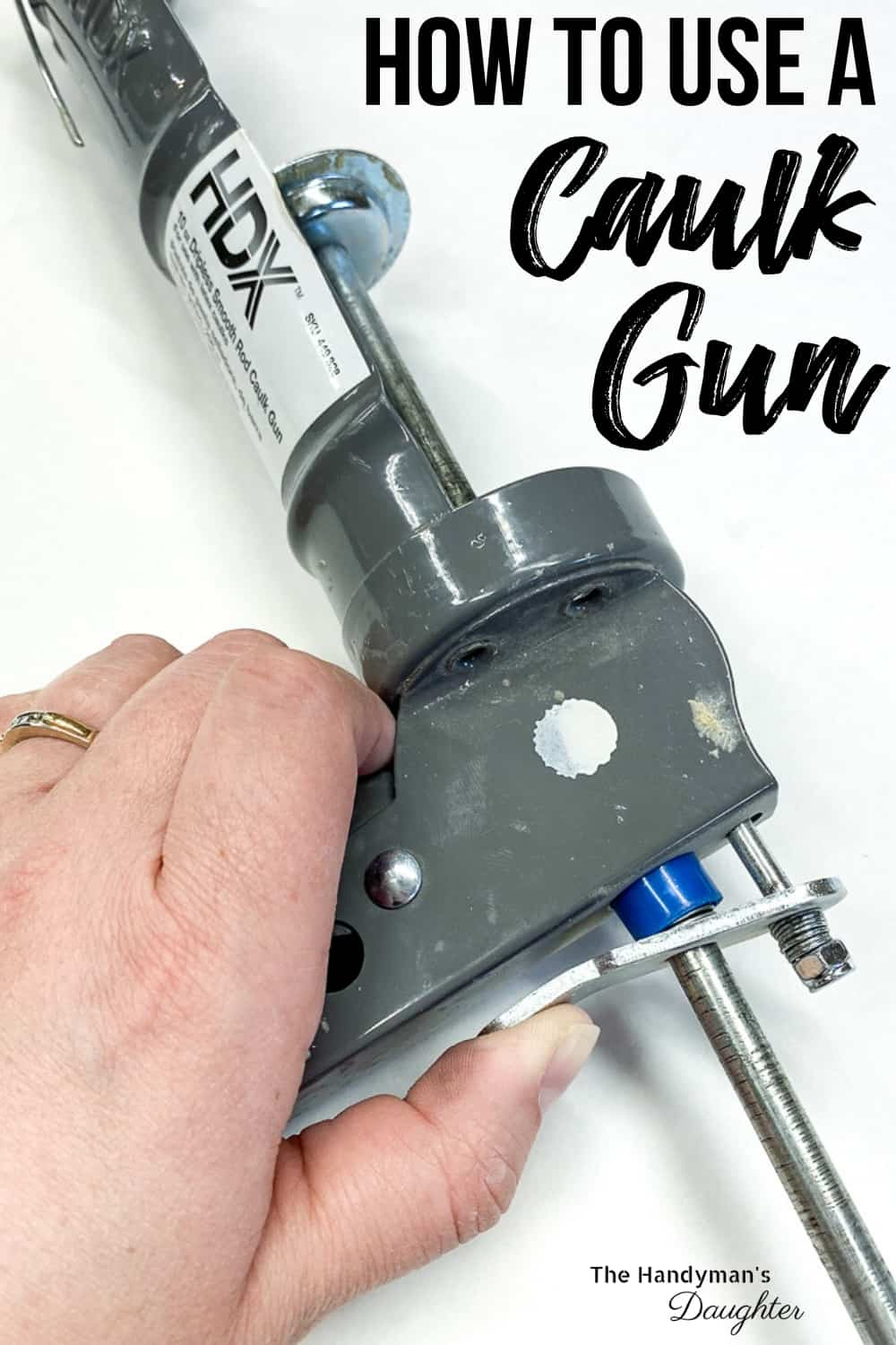 how to use a caulk gun with hand pressing the trigger