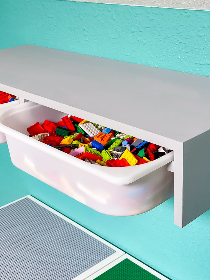 IKEA Trofast shelf with bins full of Lego pieces