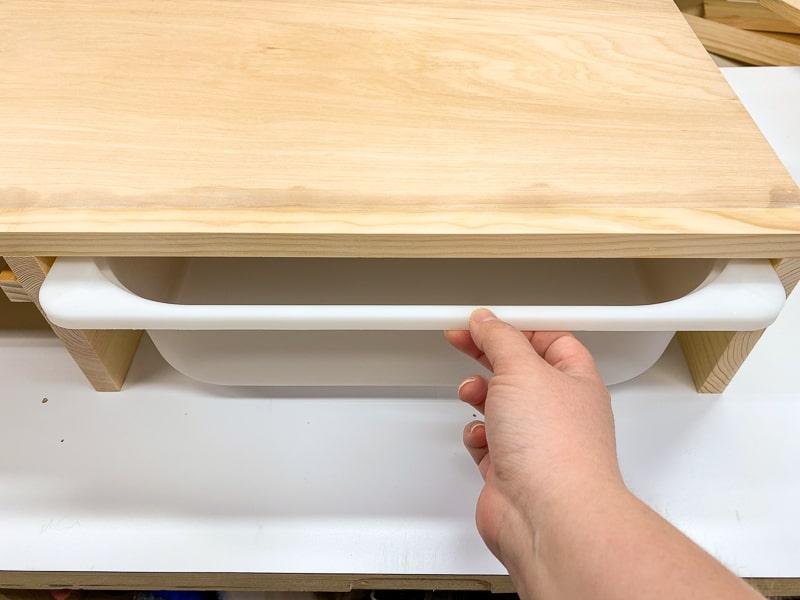 testing fit of Trofast shelf bin before painting