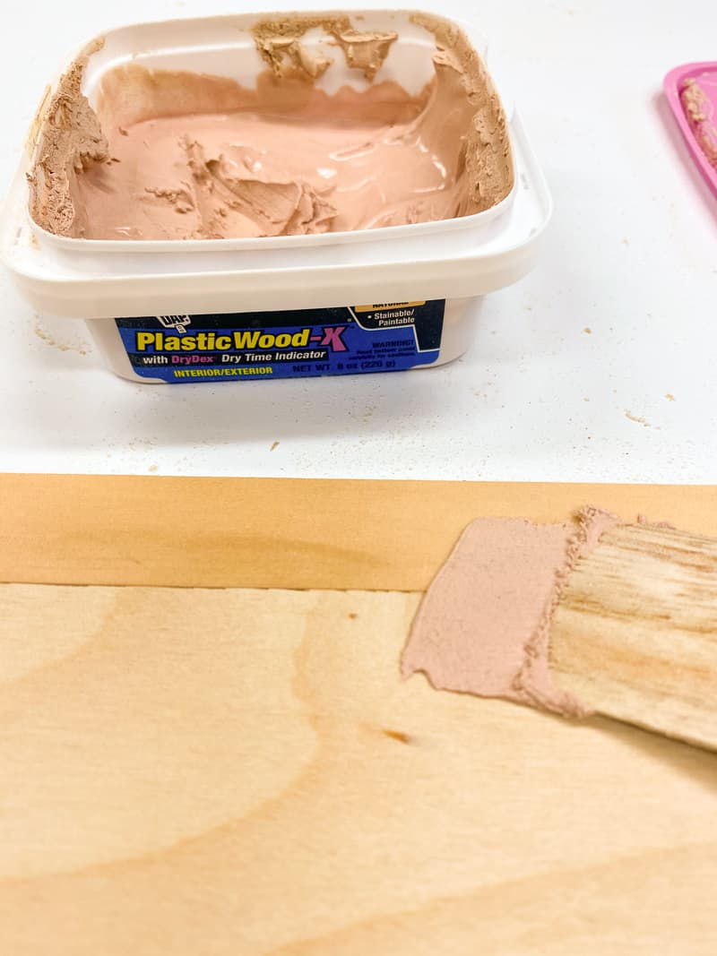 applying wood filler to seam between solid wood edge banding and plywood