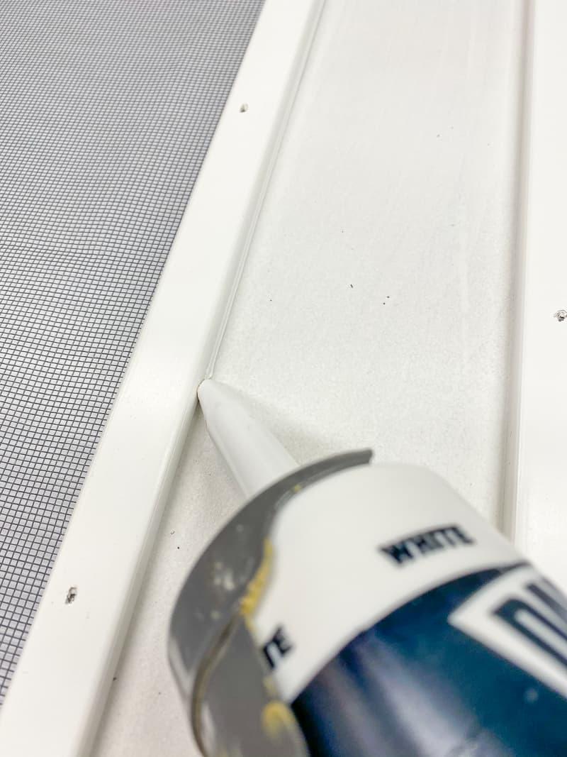 caulking seam between screen moulding and screen door frame