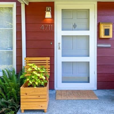 front porch with DIY screen door and planter box