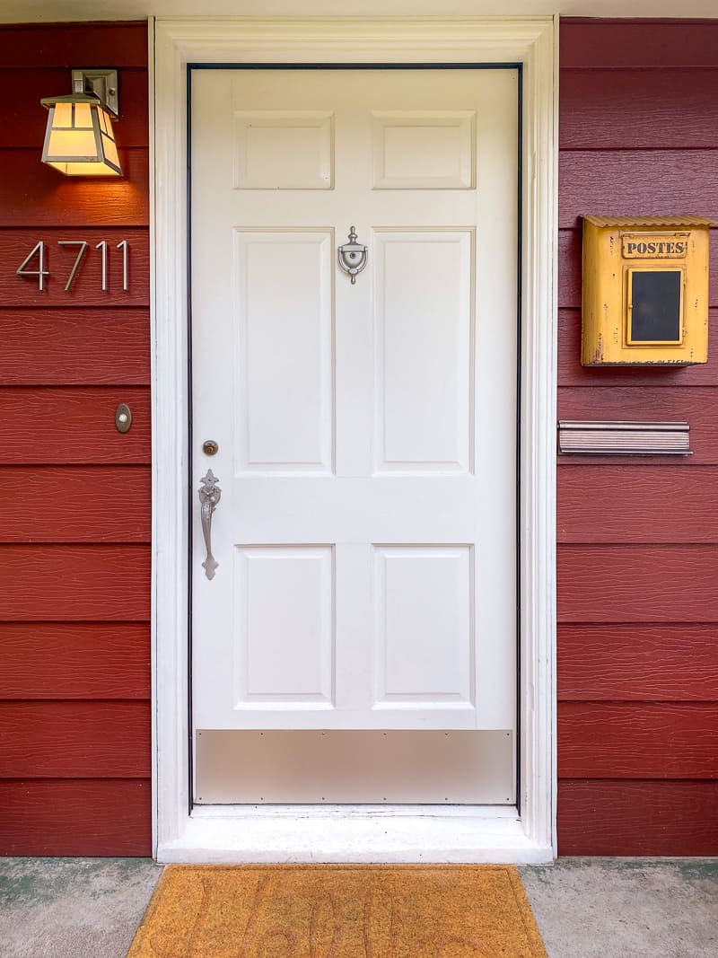 front door with mailbox and light fixture