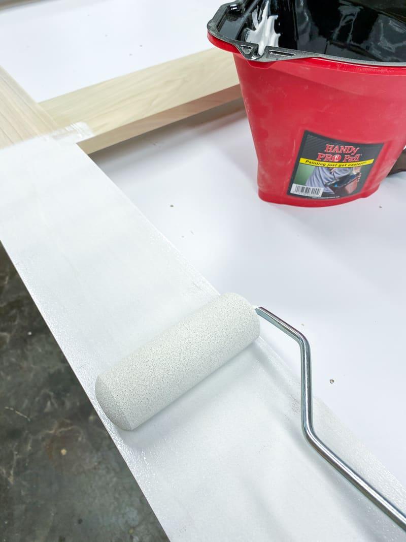 """painting DIY screen door with 4"""" foam paint roller"""