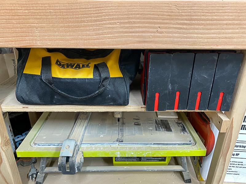 drill bag storage under miter saw stand