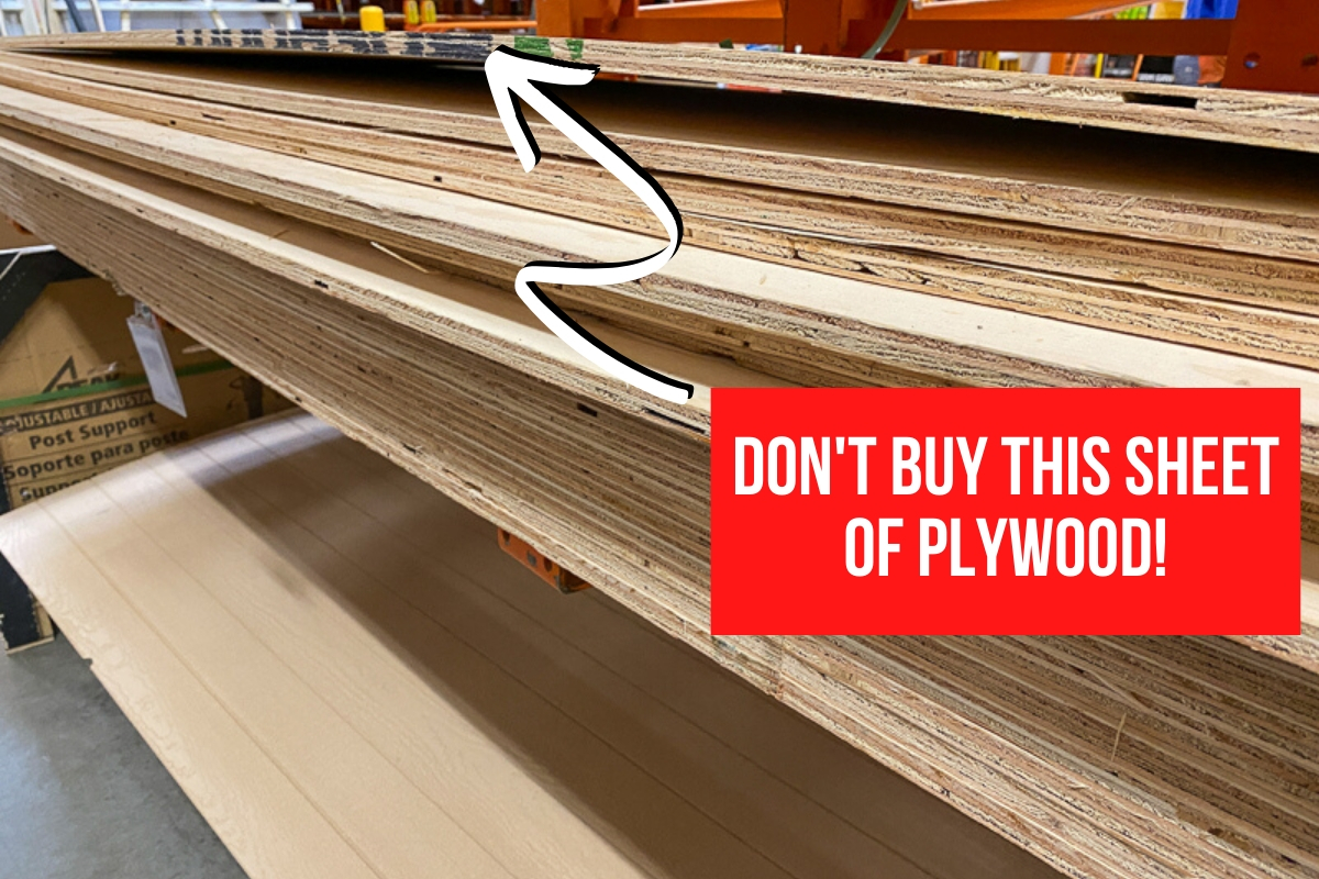 warped sheet of plywood at top of the stack