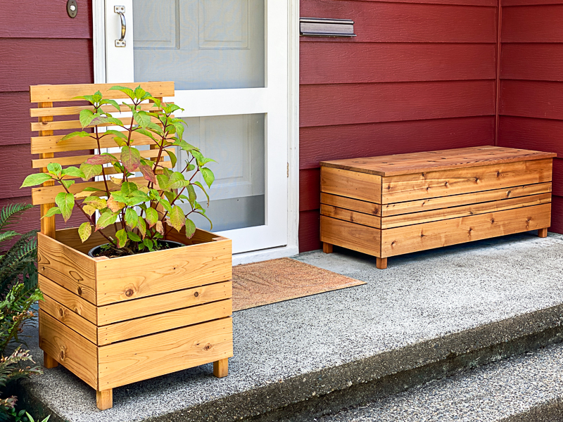 front porch with DIY planter box, screen door and outdoor storage box