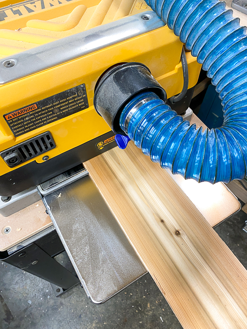 cedar fence picket passing through thickness planer