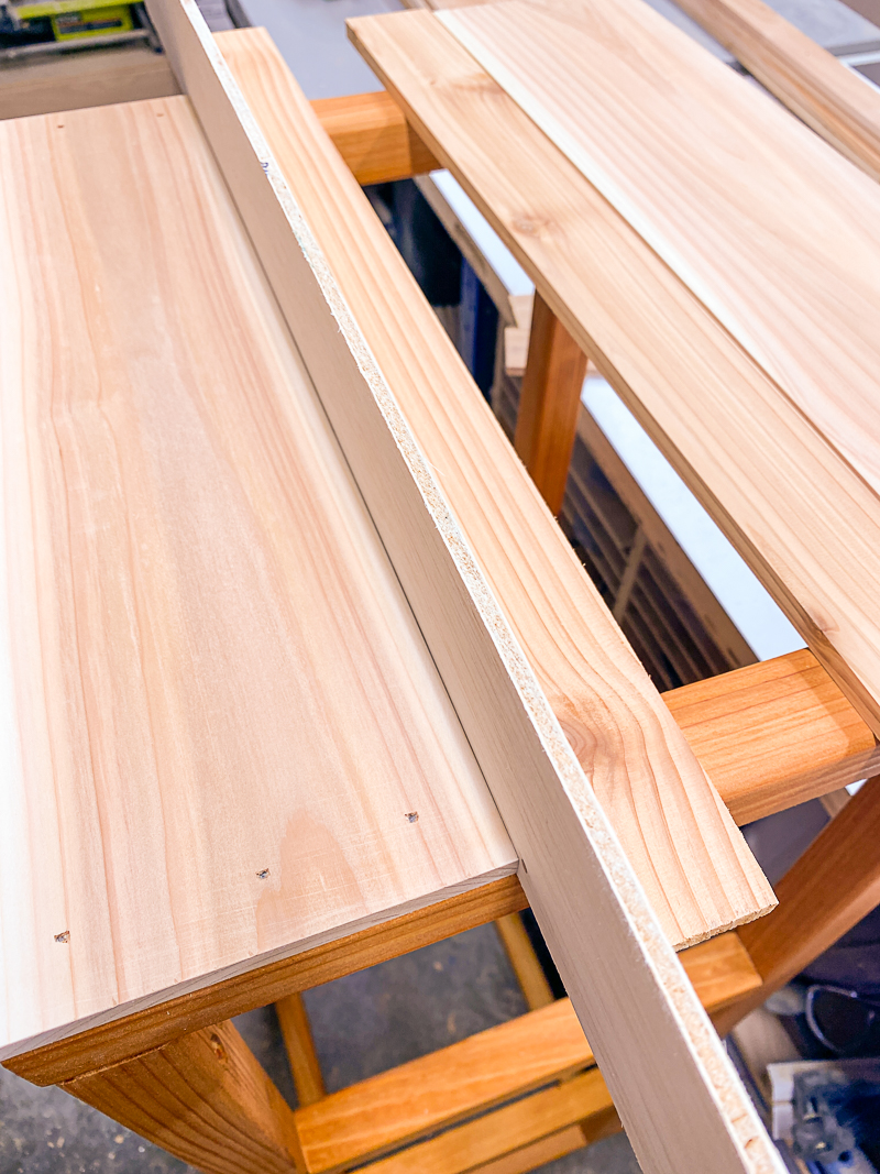 """using 1/4"""" plywood as a spacer between slats on outdoor storage box"""