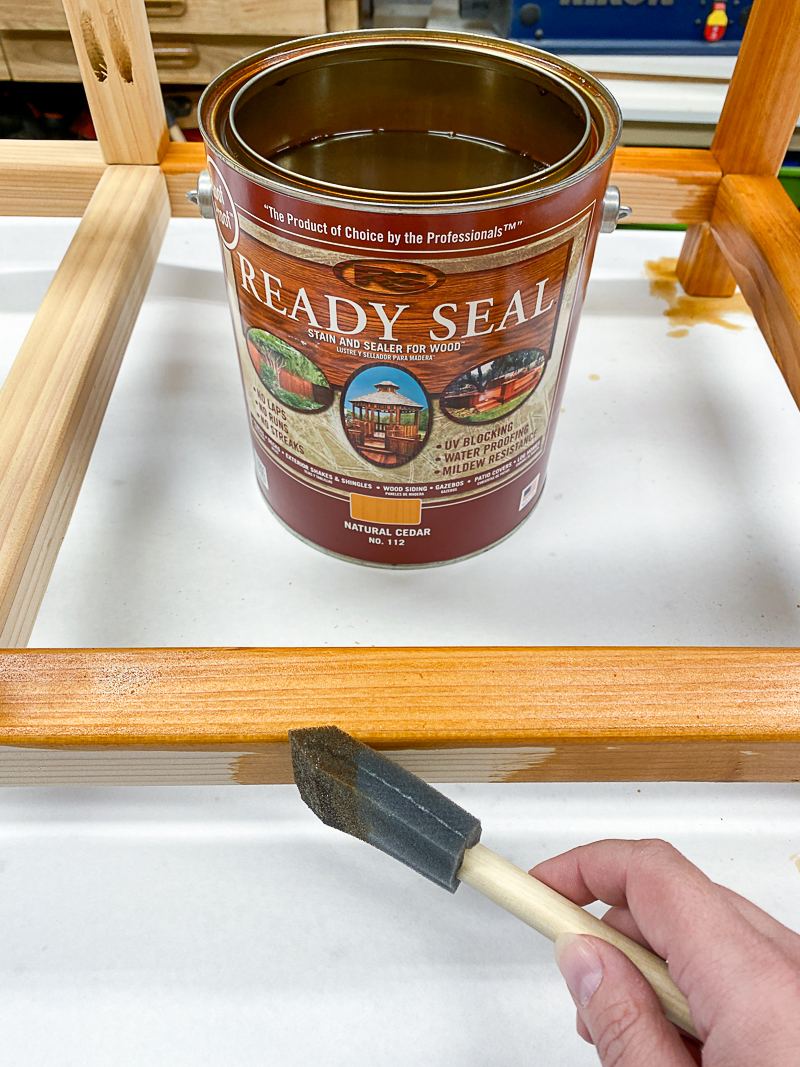 staining frame of DIY outdoor storage box with Ready Seal