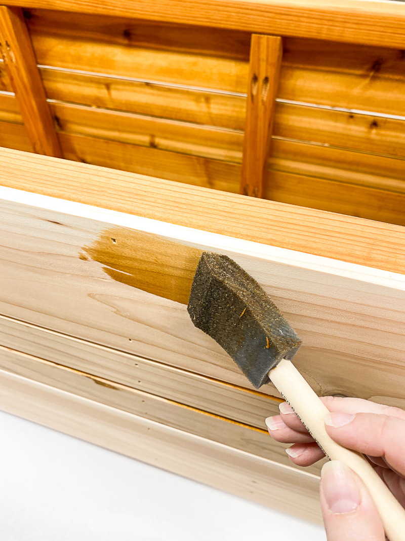 staining slats of outdoor storage box