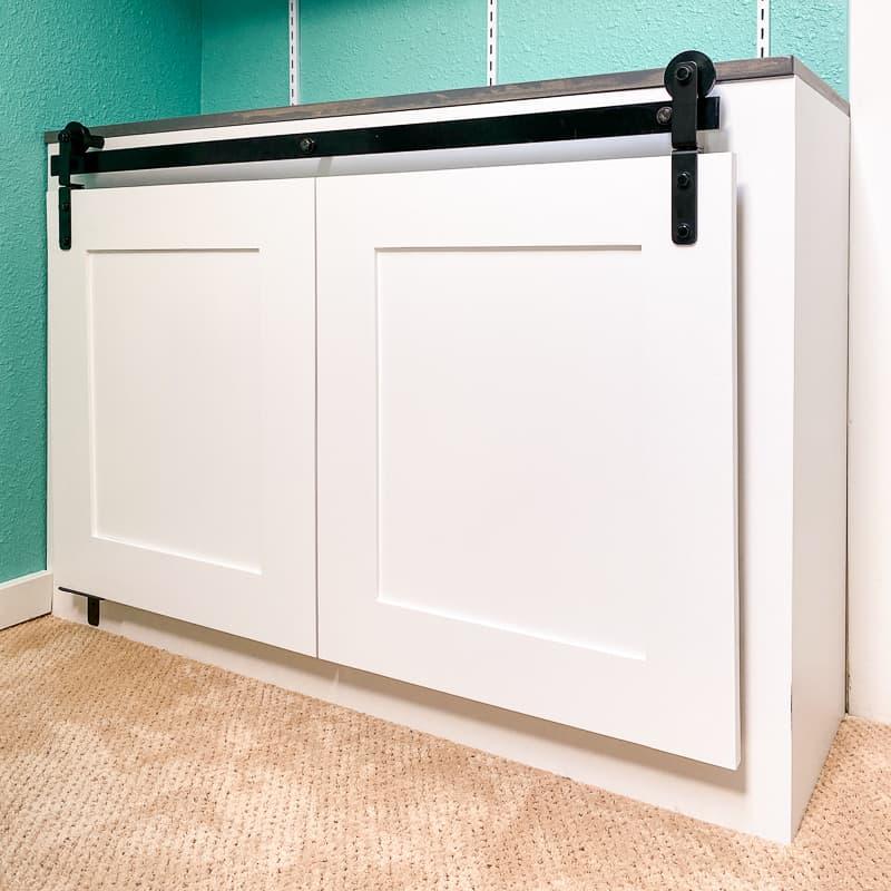 built-in cabinet with bifold barn doors