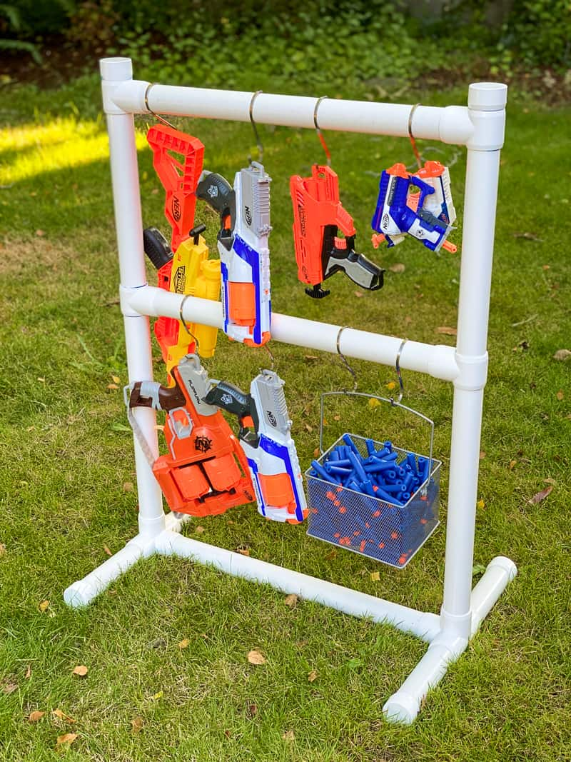 DIY Nerf gun storage rack made from PVC pipe with basket for darts