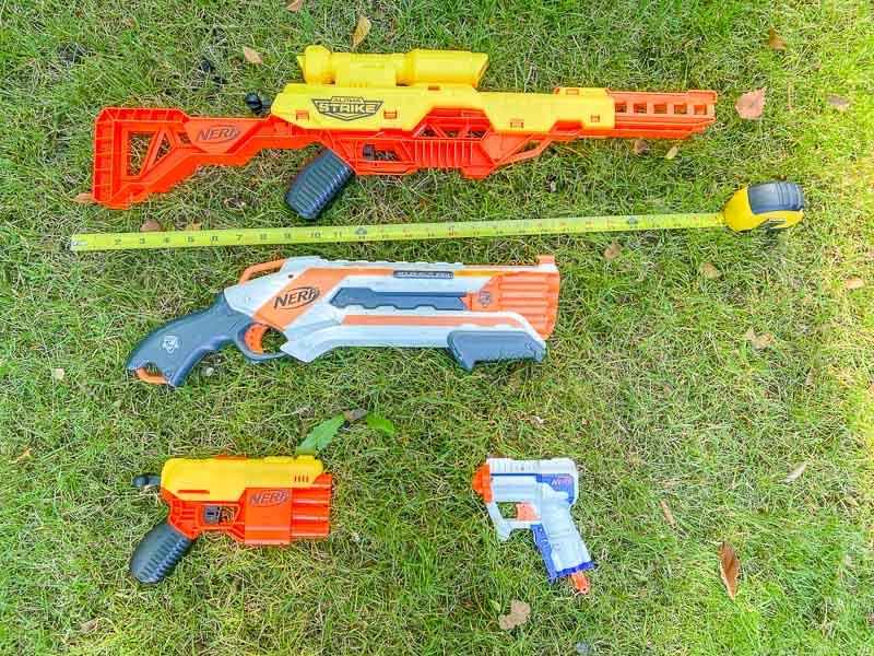 measuring Nerf gun collection to determine size of Nerf gun storage rack