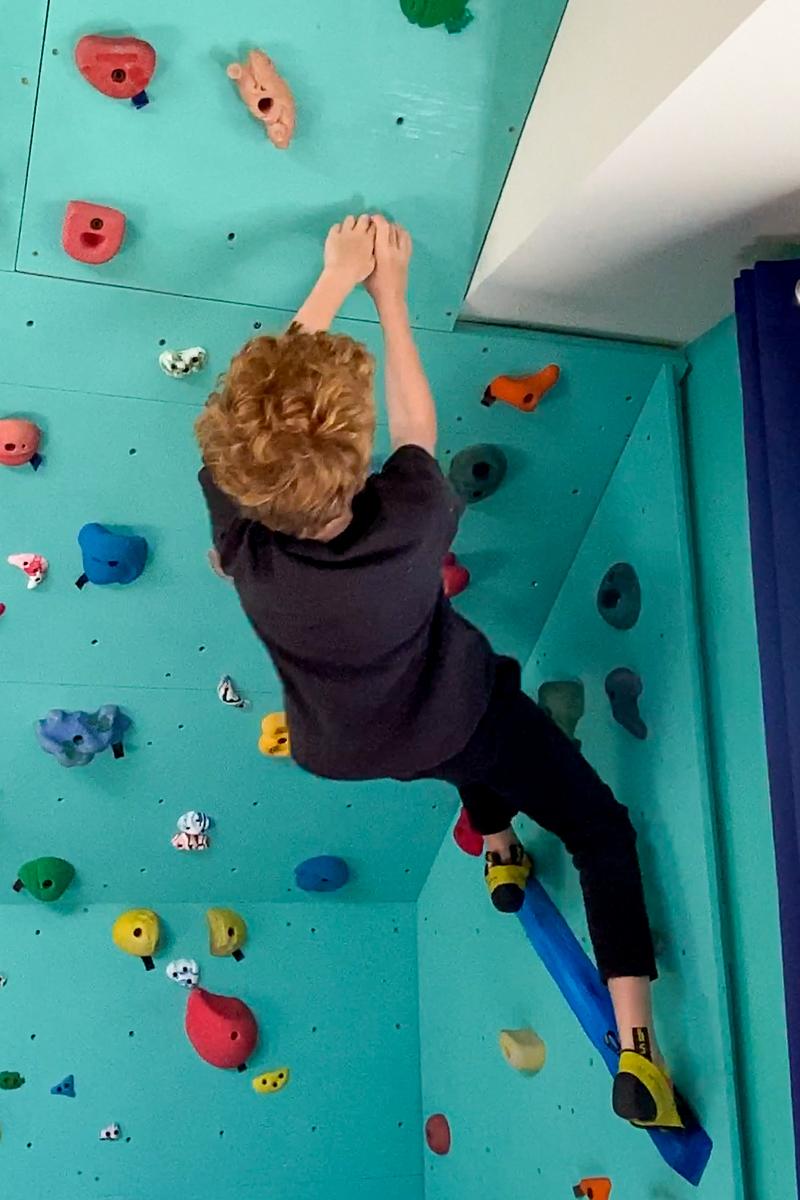 wooden climbing hold on DIY climbing wall