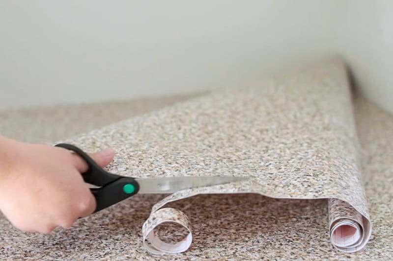 cutting patch out of leftover countertop contact paper