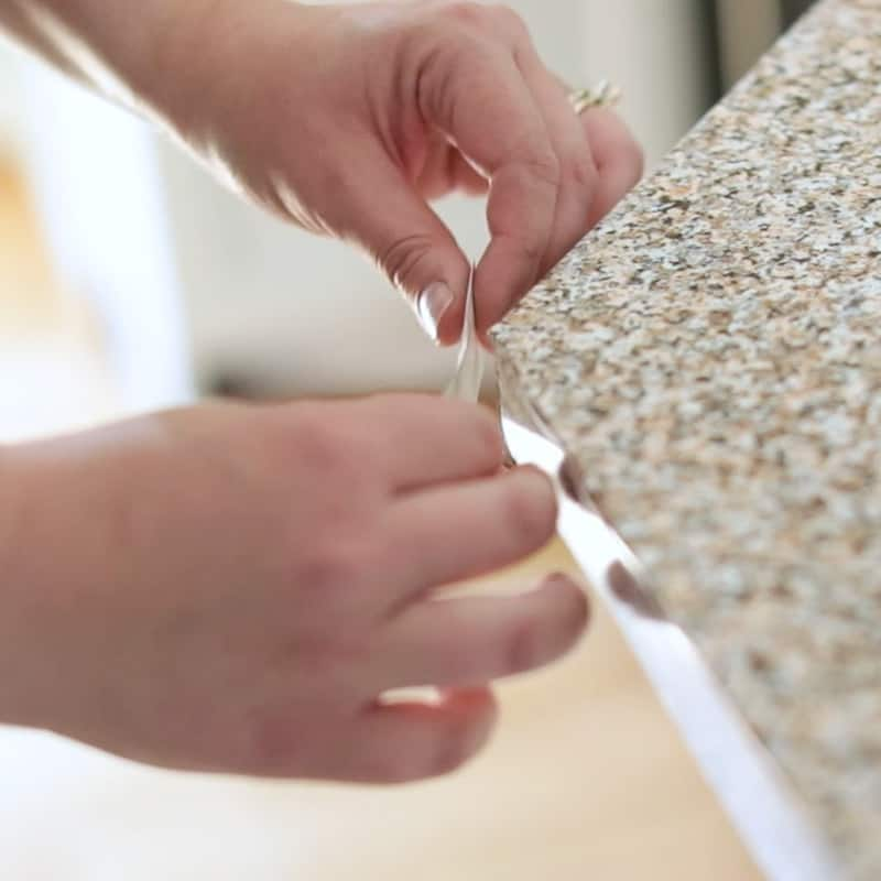 applying patch to corner of contact paper countertop