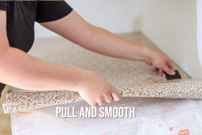 applying contact paper to countertop