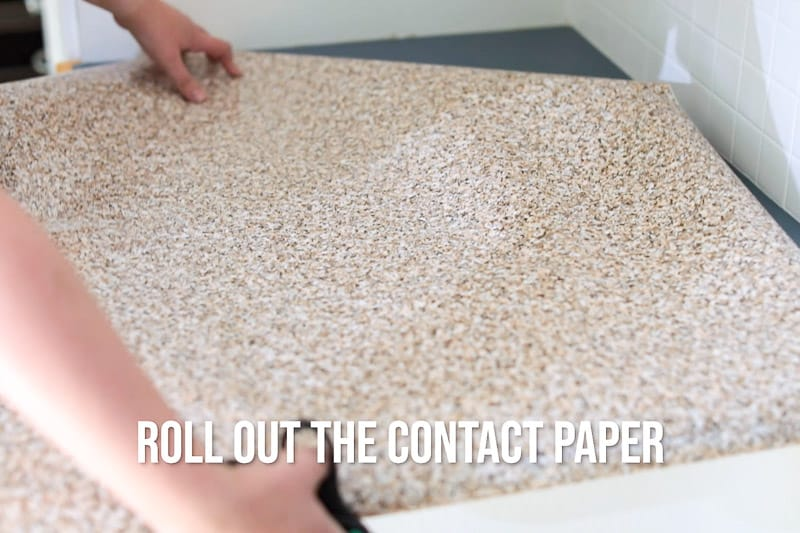 roll out contact paper over countertop to cut to size