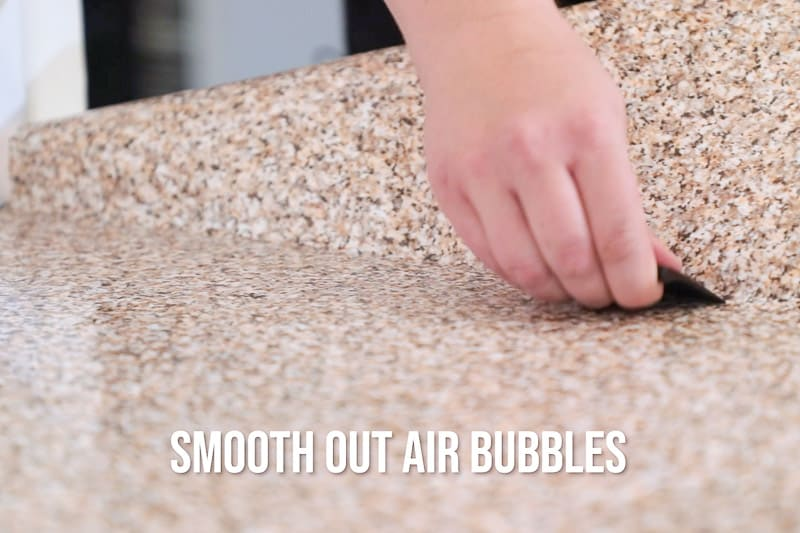 smoothing out air bubbles from countertop contact paper