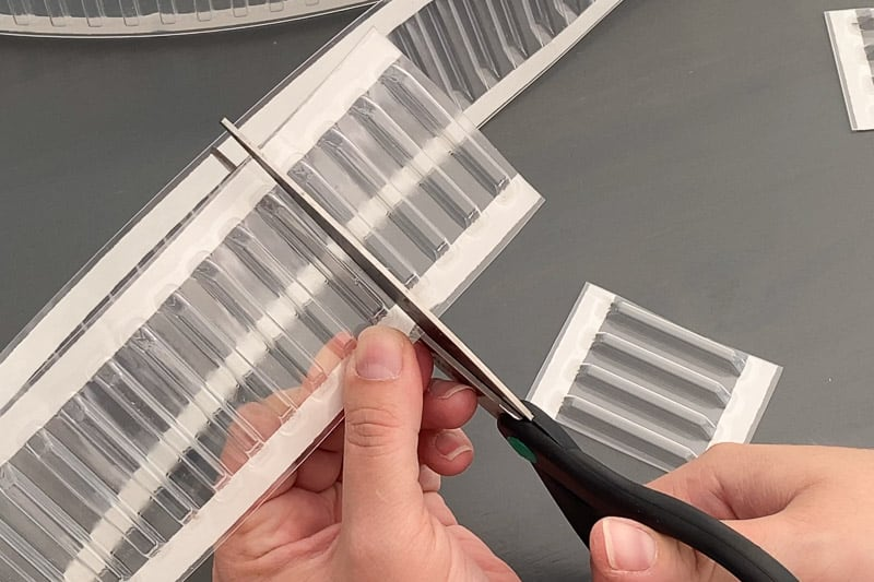 cutting drawer divider holders with scissors