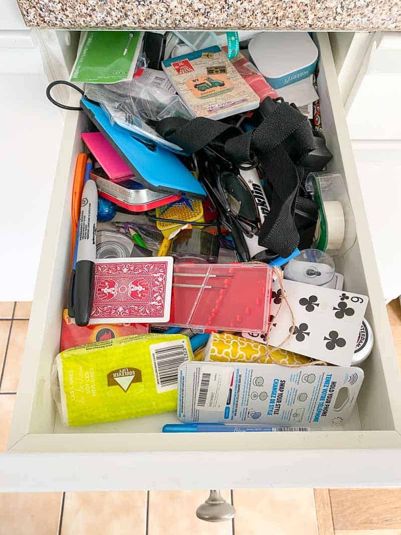 cluttered junk drawer in kitchen