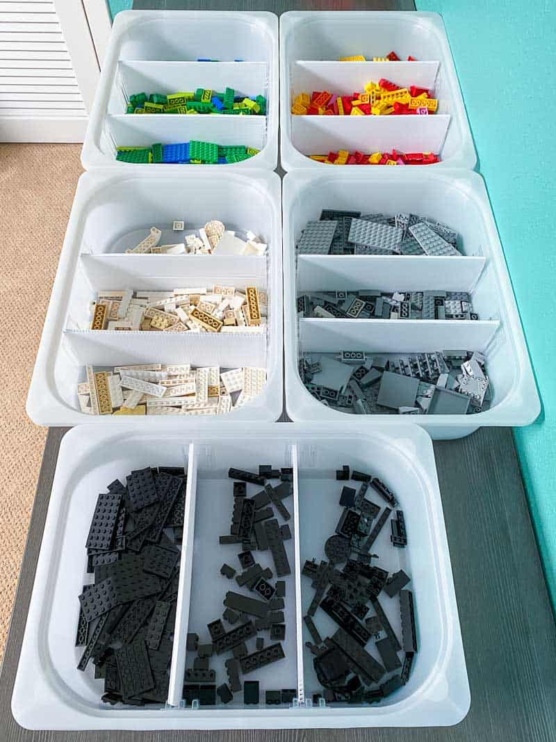 Lego pieces sorted by color and size with DIY drawer dividers in each bin