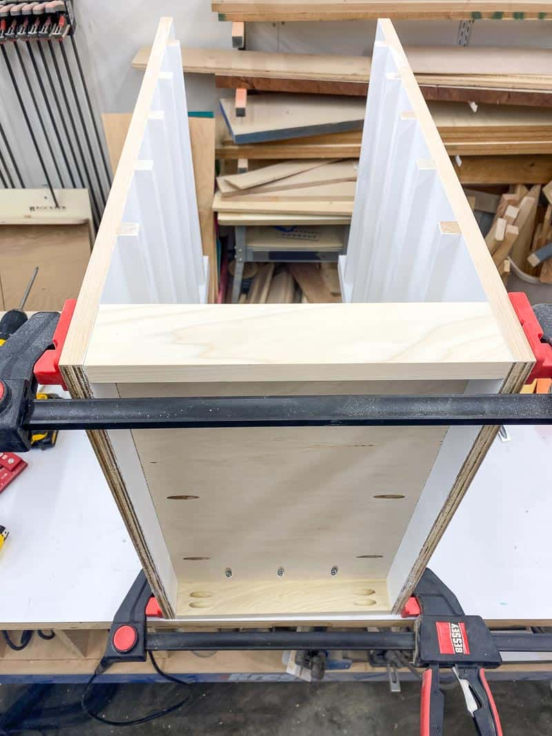 sides of Lego desk clamped to base for assembly