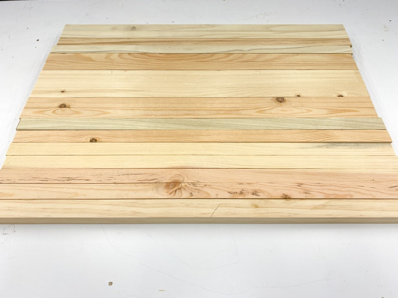 drawer runners for DIY Lego desk with X marking the cut side