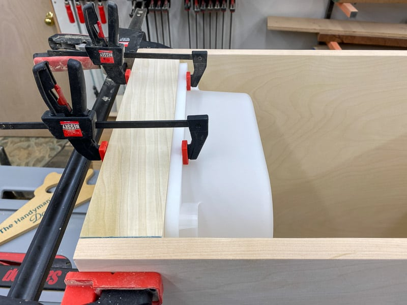 dry fit of DIY Lego desk with bin clamped to base