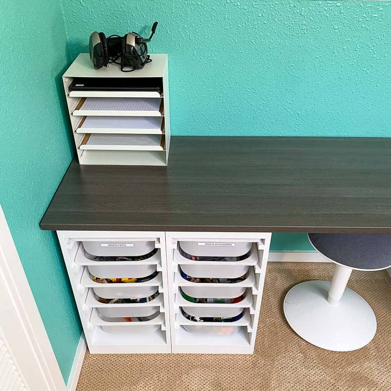 paper tray in corner of Lego desk for school supplies