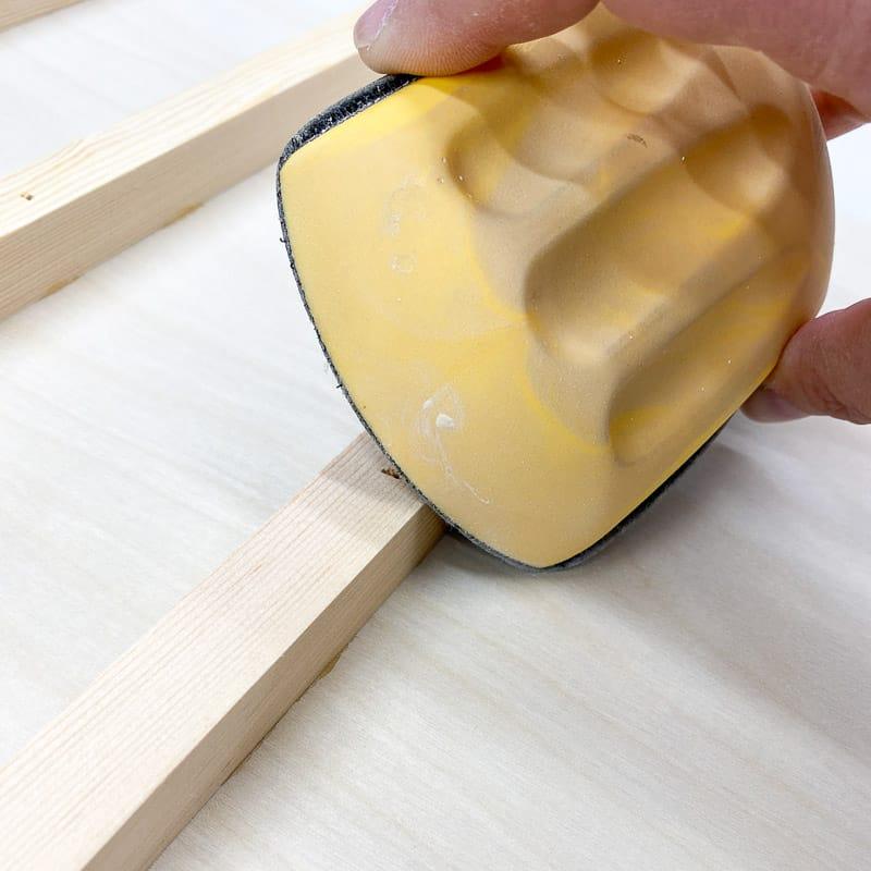 sanding sharp corners off drawer runners before painting