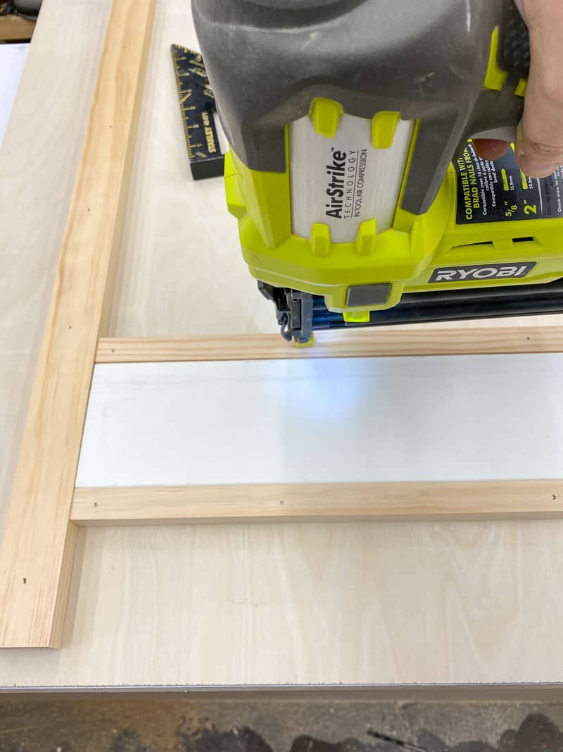 using a spacer to get even spacing between the runners of the DIY Lego desk