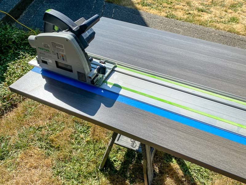 trimming the width of the Lego desk top with a track saw outside