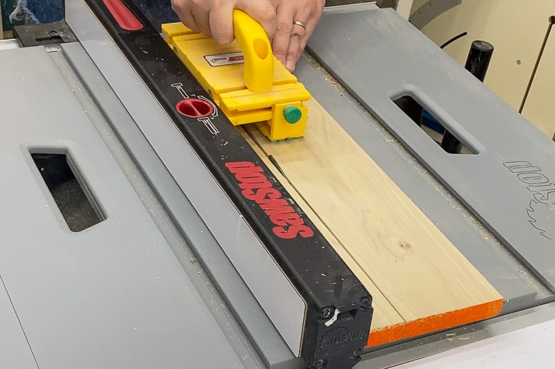 cutting sides of Lego tray to size at the table saw