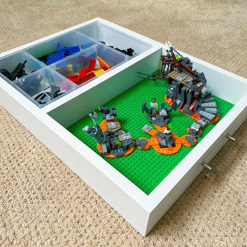 DIY Lego tray with pieces sorted in organizer and Lego project on baseplates