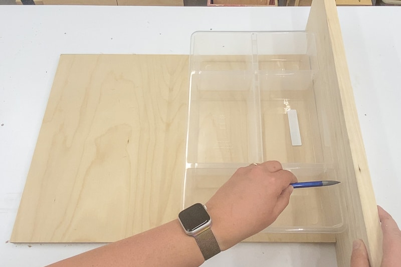 marking height of sides using the plastic organizer as reference