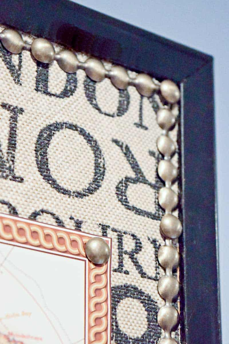 paper map attached to corkboard with nailhead pin