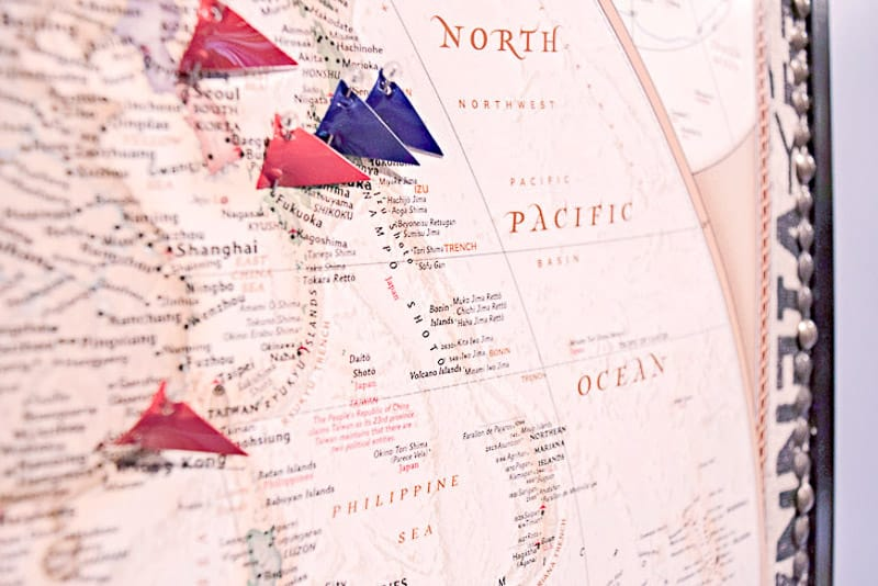 DIY push pin travel map with flags marking locations